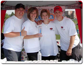 (From left) Steve & Marcia Victor and Kelli & Joe Victor quench a walker's thirst with refreshing Perfect Water.
