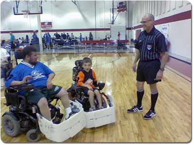 From left: 'Mo' (Matthew Gerhardt) and 'Full Throttle Gabe' (Gabe Myers) of the Capital City Cobras find an outlet for their passion for sports in Power Soccer.