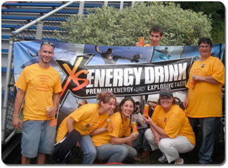 Running the XS Energy Drink booth are, from left, Daniel Marville, Katie Shaffer, Marissa Matas, Rochelle Dutt, Jere Dutt, and, behind the sign, Mike Brooks.
