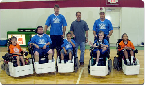 Capital City Cobras organizer Eric Rasche (center, standing) takes his  team to the national championships in Indianapolis.