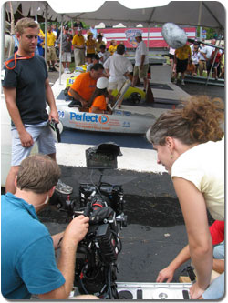 The 'Perfect' Soap Box Derby car sponsored by Jere and Rochelle Dutt prepares for its race while a film crew captures a scene for '25 Hill.'