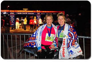 Pam and her sister Bonnie accept their medals at the finish line.