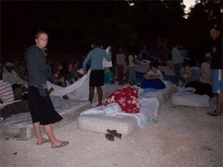 Sixty mission volunteers sleep in the driveway outside their guesthouse the night after the earthquake.