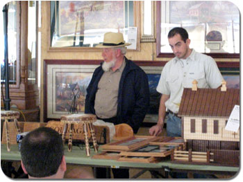 Ervin Raber, left, helps the Haiti Benefit Auction raise funds  for Haiti auctioning Amish and Mennonite goods in Indiana, Ohio, Illinois, Kentucky, Pennsylvania, New York, and Florida.