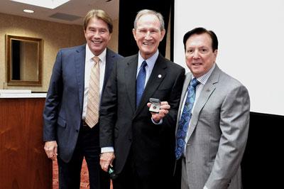 Bob Andrews receives diamond pin.